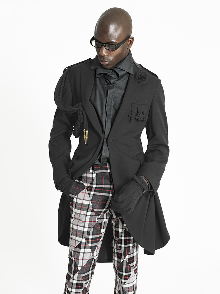 draped over coat x tartan patchwork trousers