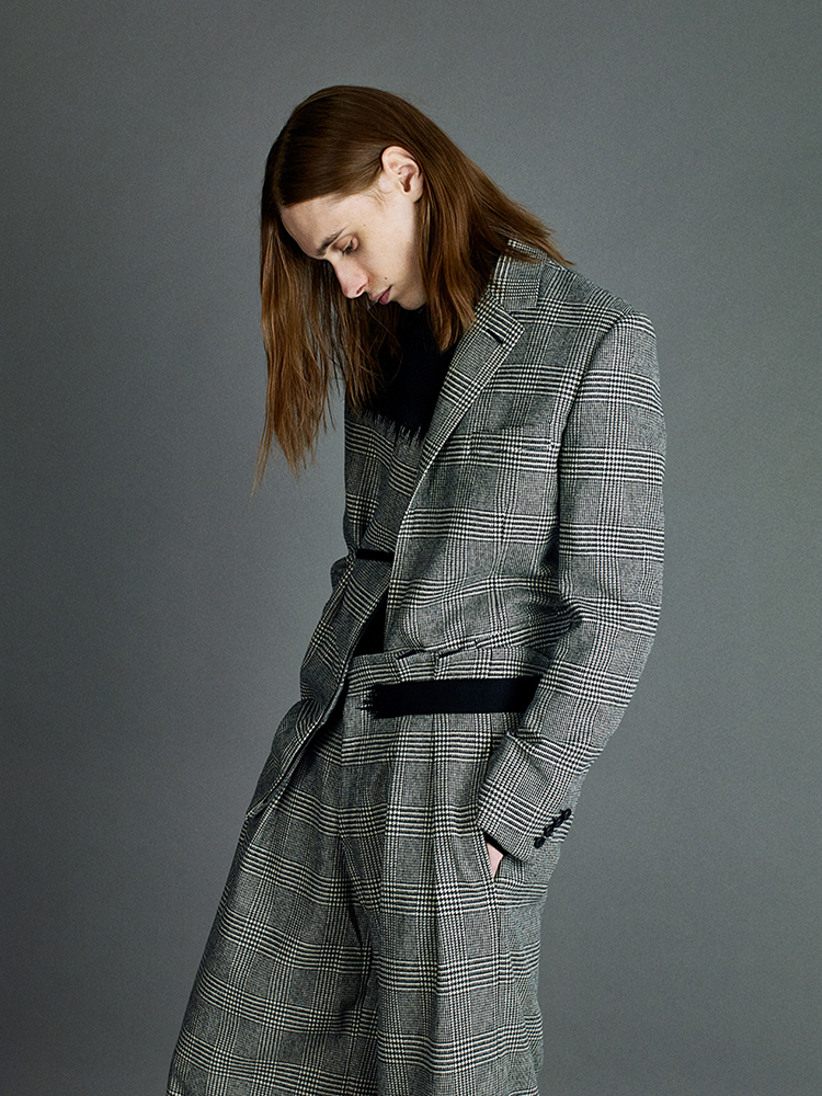 single breasted jacket and double pleated trousers in glen check