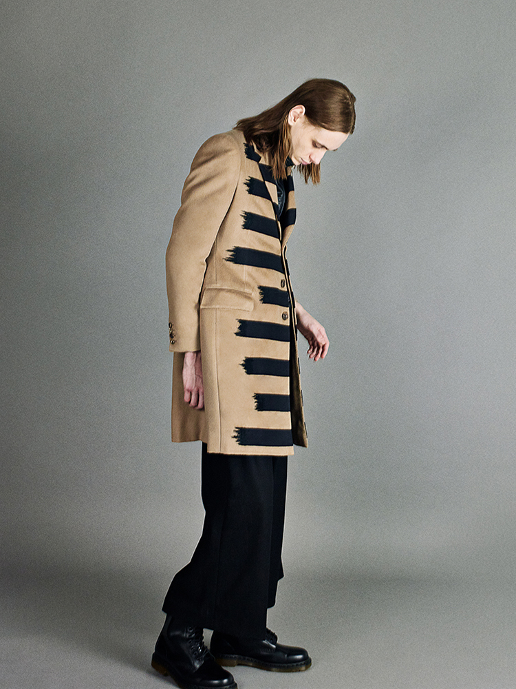 beige single breasted overcoat with taped details